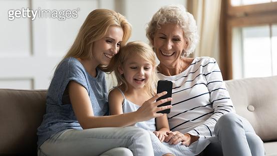 Happy 3 generations family having fun at home.