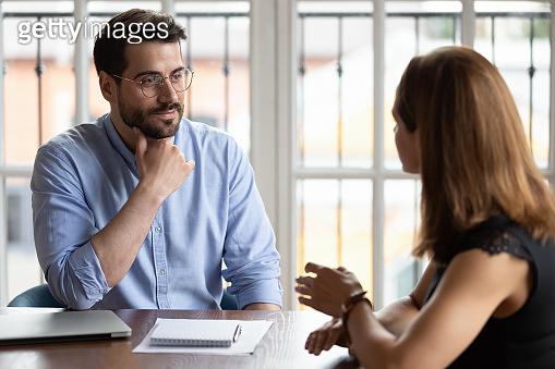 HR manger listening female applicant during job interview