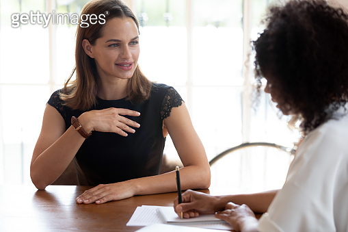 African HR manager interviewing caucasian applicant during job interview