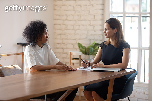 African woman passing job interview communicating with HR manager businesswoman