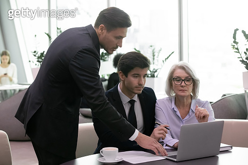 Businesspeople ceo using laptop analyzing financial data company state