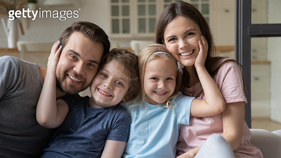 Portrait of happy family relax at home together