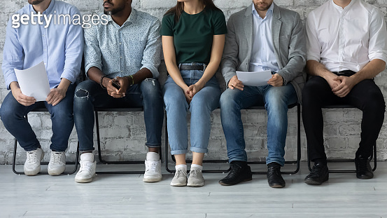 Anxious work applicants sit in line wait for interview