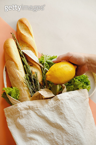 Organic vegetables, lemon and, long loaf in eco bag tote in market.  Products in fabric linen bag in organic food store.  Healthy nutrition, Zero Waste, Concept. Banner for for web, design. Mock up