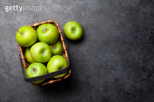 Ripe green apple fruits on dark stone table
