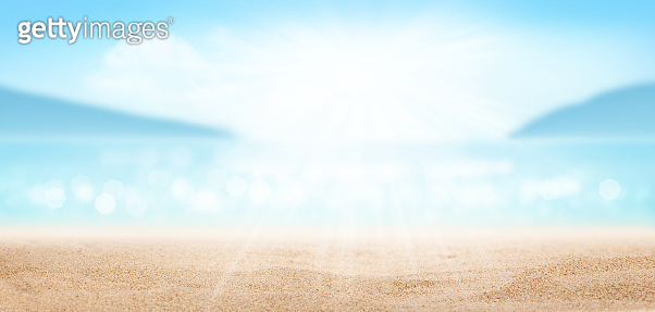 Summer tropical sea with sparkling waves, sand and blue sunny sky