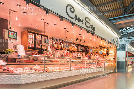 Different cuts of fresh beef, pork, lamb and other meats for sale at famous at  Lonely Planet Barcelona's Sant Antoni Market in Barcelona spain Concepts could include food, health, culture, travel, and others