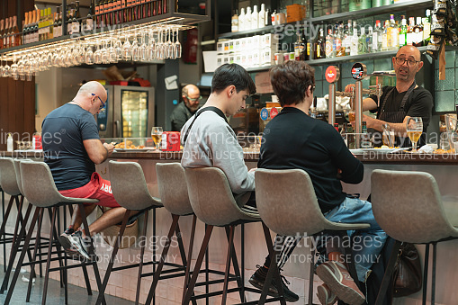 People eat at Lonely Planet Barcelona's Sant Antoni Market in Barcelona spain Concepts could include food, health, culture, travel, and others