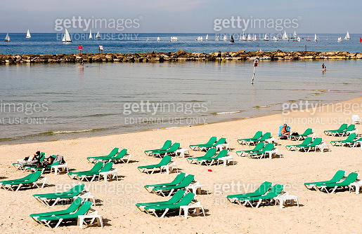People are relaxing on the beach of Tel Baruch in Tel Aviv.