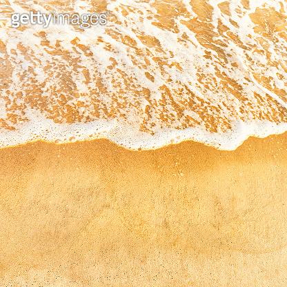 Beach sand and ocean wave
