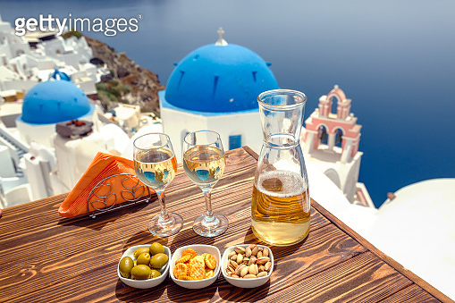 Bottle of wine and two glasses on Santorini