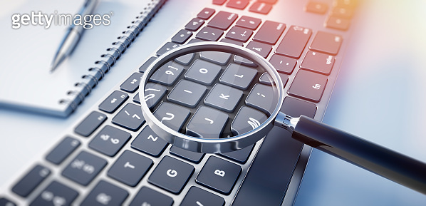 Magnifying Glass on Computer Keyboard