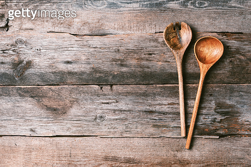Wooden spoon on rustic texture. Old vintage kitchen utensils. Top view, copy space. Banner
