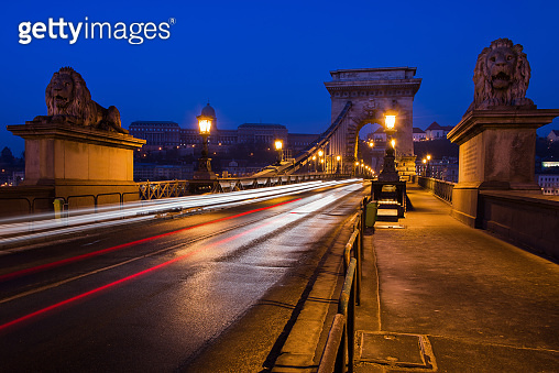 Beautiful Long exposure image of Chain Bridge in Budapest, Hungary. View of light trails along the road. Night photography.
