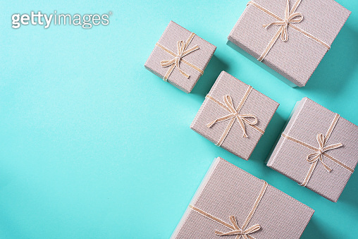 Valentine's Day. Golden gift box on blue background. Top view. Copy space. Festive backdrop for holidays: Birthday, Valentines day, Christmas, New Year. Flat lay style. Banner