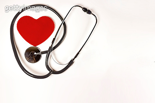World health day, Healthcare and medical concept. Red heart with Stethoscope on white background texture.
