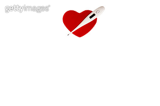 Electronic thermometer and red heart isolated on white background with copy space for your text. Health care.