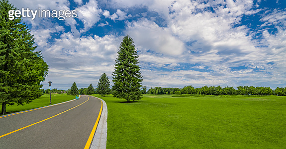 Good road near golf course in beautiful green park at Mezhgorye residence, Ukraine