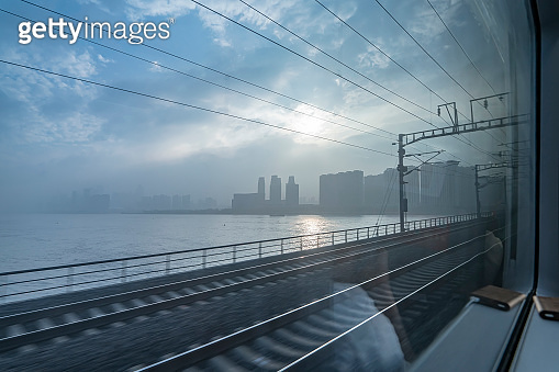 Travel by train. View from window with no people. Urban transportation background