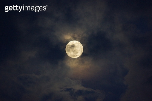 Full Moon amidst clouds