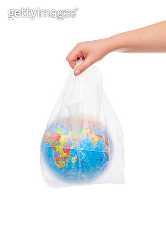 Young woman hands holding an earth globe in a plastic bag