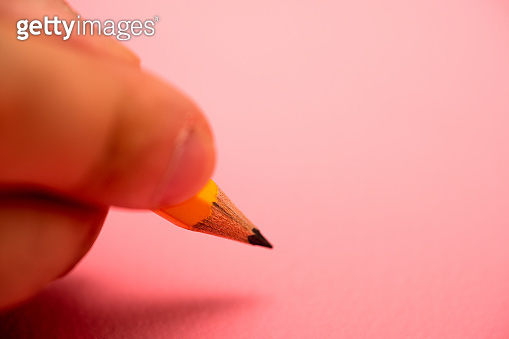 Yellow Pencils on Pink Background stock photo