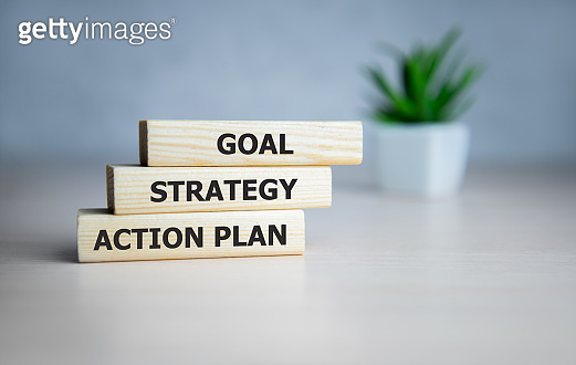 business text on wooden blocks, business process concept goal - strategy - action plan