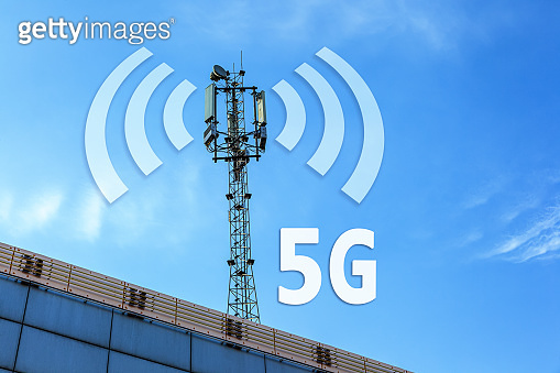 3G, 4G and 5G cellular communications tower with clear sky and space for text.