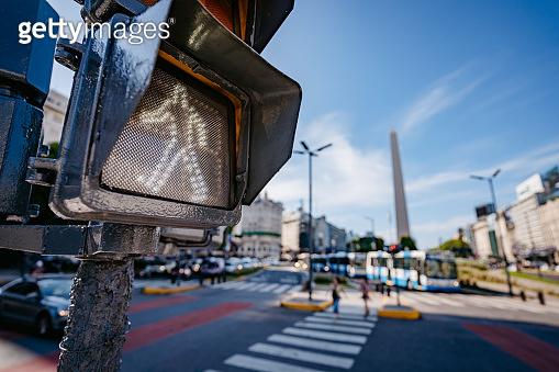 Pedestrian crossing red traffic light