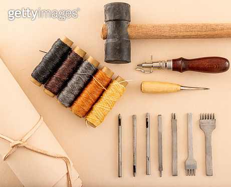 Leather working tools and rolled up hide organized