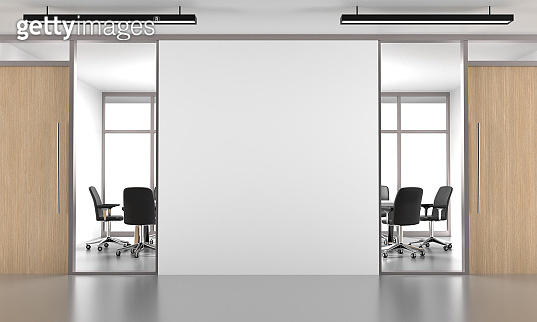 White Open Space Office with Empty Wall and White Windows