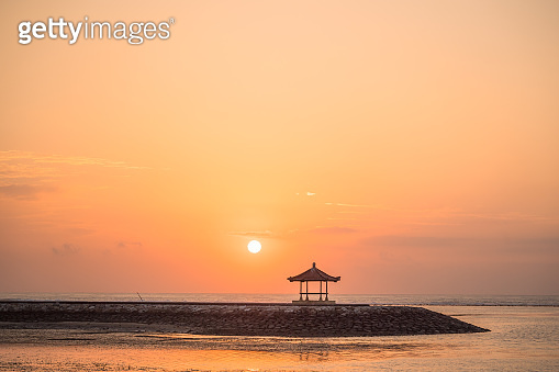 Wide Agnle view of tropical beach sea at sunset in Bali Island , Indonesia