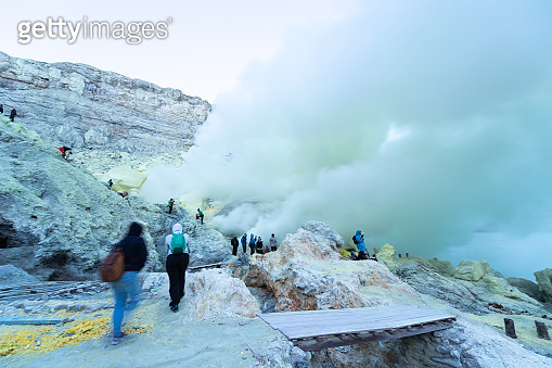 Sulfur lake and smoking mine mountain  in the morning at Kawah Ijen volcano East Java Indonesia