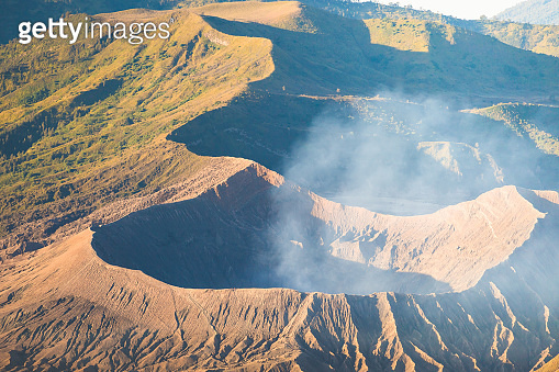 Early morning view of the Bromo caldeira in East Java in Indonesia. The volcanic formation of a few volcanoes, with the famous volcano Bromo and the Semeru volcano in the background