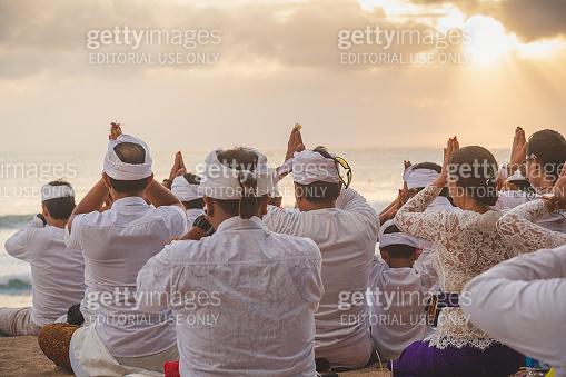 People praying during celebration Balinese ceremony at Pura Goa Lawah temple, Bali, Indonesia