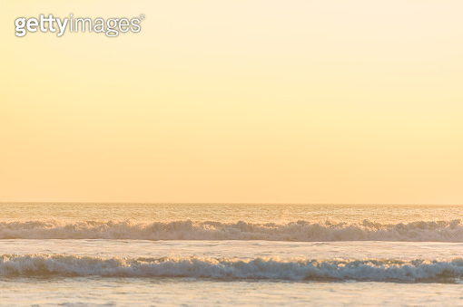 Sunset near famous tourist landmark of Bali island - Wide Agnle view of tropical beach sea at sunset in Bali Island , IndonesiaTropical nature landscape of Indonesia, Bali.
