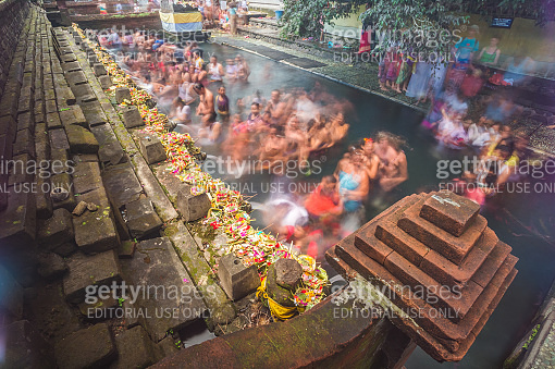 People praying in Temple Tirta Empul on the north of Bali indonesia