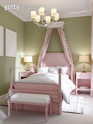 Childrens bedroom with a large pink bed and a canopy over, pistachio-colored walls.