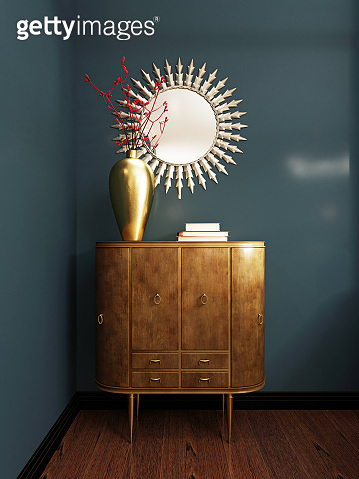 Wooden classic style chest of drawers with mirror over, against the background of a blue wall. Chest of drawers with decor.