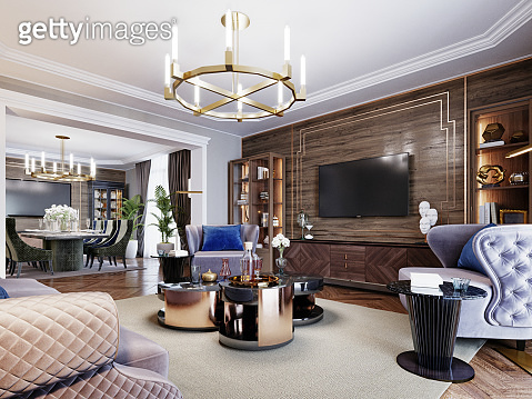 Fashionable designer living room interior in warm colors. Artdeco upholstered furniture, coffee table, side table with lamp, metal floor lamp, sideboard with decor and TV unit.