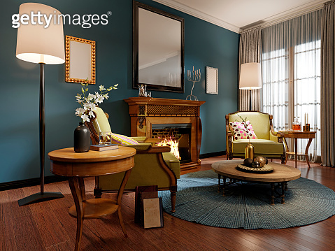 Relaxation area of the classic-style living room with wooden armchairs with light green leather upholstery. Luxurious carved wood fireplace. Deep blue walls.