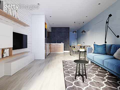 small studio apartment with kitchen, dining room and living room with sofa. Interior in blue and white colors and wooden elements.