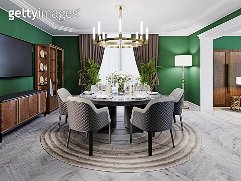 Luxurious dining room in a large house, with a round table for six people. Leather chairs, marble countertops, TV unit, sideboard, green walls.
