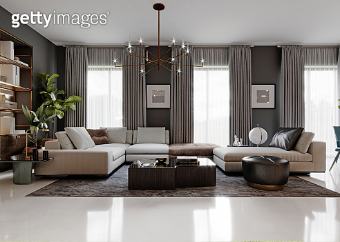 Fashionable large transformer sofa with corner elements in a modern living room with gray walls and large windows. Front view.