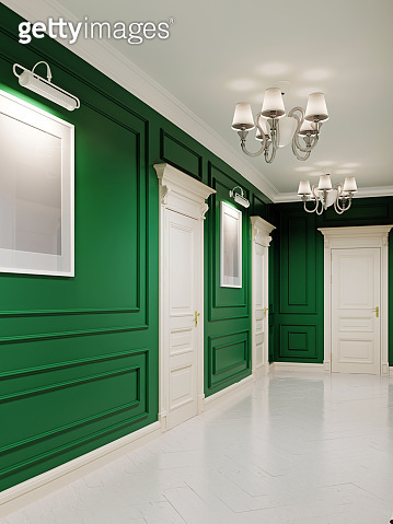 Classic style corridor with green walls and white doors and wood-paneled walls. The paintings on the walls.