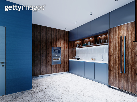 Fashionable little kitchen with blue walls and blue and brown wooden meels.