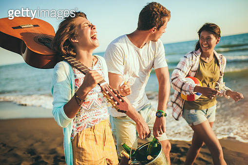 Young people looking happy on vacation. They are go on the beach party.