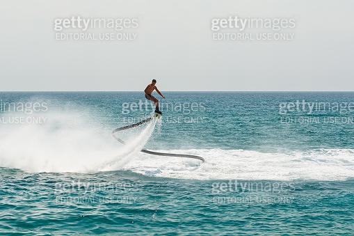 Professional fly board rider on Mediterranean Sea. Water summer extreme sports concept. Kemer, Turkey.