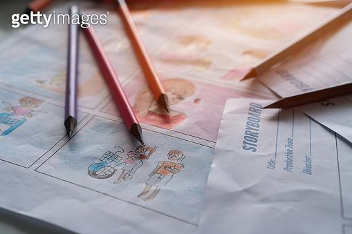 Color pencils on Document for Designer creative drawing in storyboard for film movie, Video Pre-production process in display script. Design shot scene layout template on desk studio. Media product