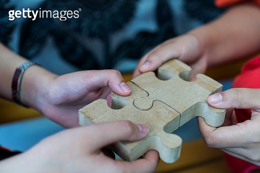 Businesswoman hand of Teamwork holding jigsaw puzzle connecting, Business team work of solutions in success strategy concept